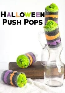 Easy Halloween Push Pops - Fun and colorful halloween colored push pops filled with vanilla frosting and vanilla cake colored black.