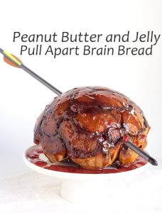 Peanut Butter and Jelly Pull Apart Btain Bread - The perfect way to celebrate The Walking Dead. Biscuit pockets filled with peanut butter and strawberry jam and then glazed with a strawberry jam.