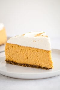 slice of sweet potato cheesecake on white plate