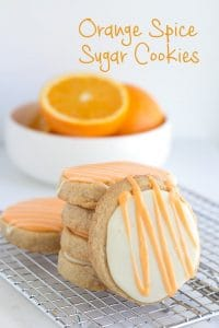 Orange Spice Sugar Cookies - These cookies have specks of cinnamon and orange zest throughout them. They make the perfect freezer cookie. I topped my orange spice cookies with an orange flavored royal icing to give it an extra punch of flavor.