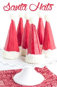 Santa Hats - a fun pinata treat for kids! Stuff some waffle cones with festive m&m's and let the magic happen.