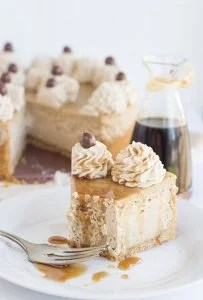 a slice of Coffee Cheesecake with a bite taken out of it