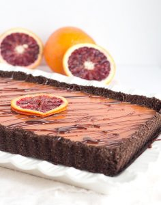 Chocolate Blood Orange Tart - chocolate graham cracker crust with a blood orange curd and a milk chocolate ganache drizzle.