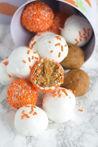 Cream Cheese Carrot Cake Cake Pops - delicious homemade carrot cake with a cream cheese frosting, coated with white chocolate and sprinkles.