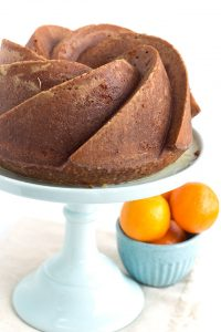 Orange Olive Oil Cake on a cake stand