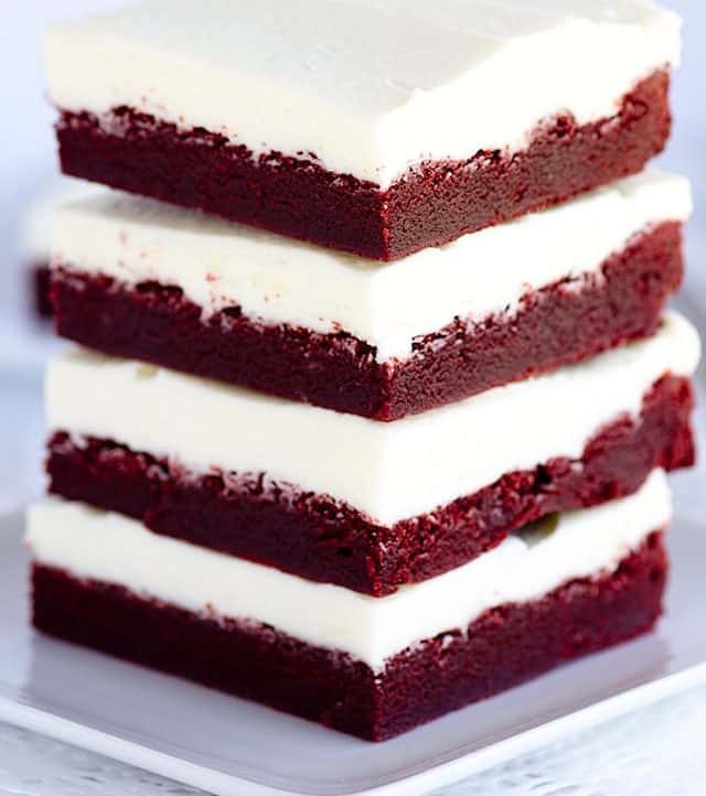 Chewy Red Velvet Bars - delicious chewy red velvet bars with the perfect white chocolate frosting!