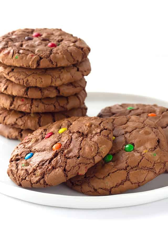 Brownie Cookies are rich chocolate cookies loaded with semi-sweet chocolate chips with a shiny crispy brownie top, studded with M&M chocolate candies.