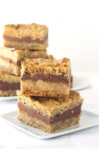 Chocolate Peanut Butter Oatmeal Bars - oatmeal bars made from peanut butter oatmeal cookie dough with a chocolate cheesecake filling in the middle!