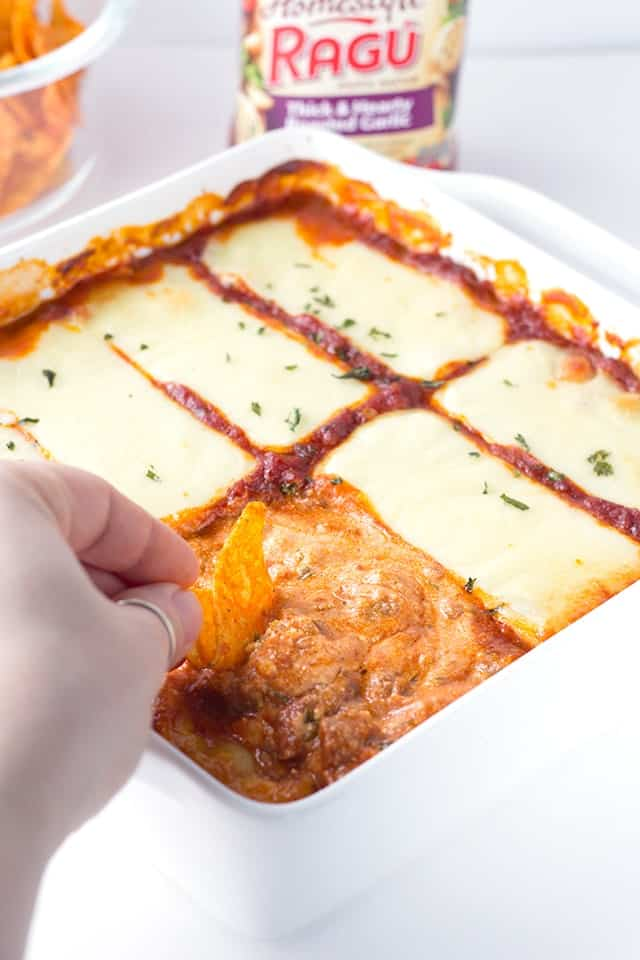 Lasagna Dip - Loaded with ricotta, mozzarella, and parmesan cheeses as well as hot sausage and Ragu sauce! This cheesy dip is amazing piled on bread or chips!