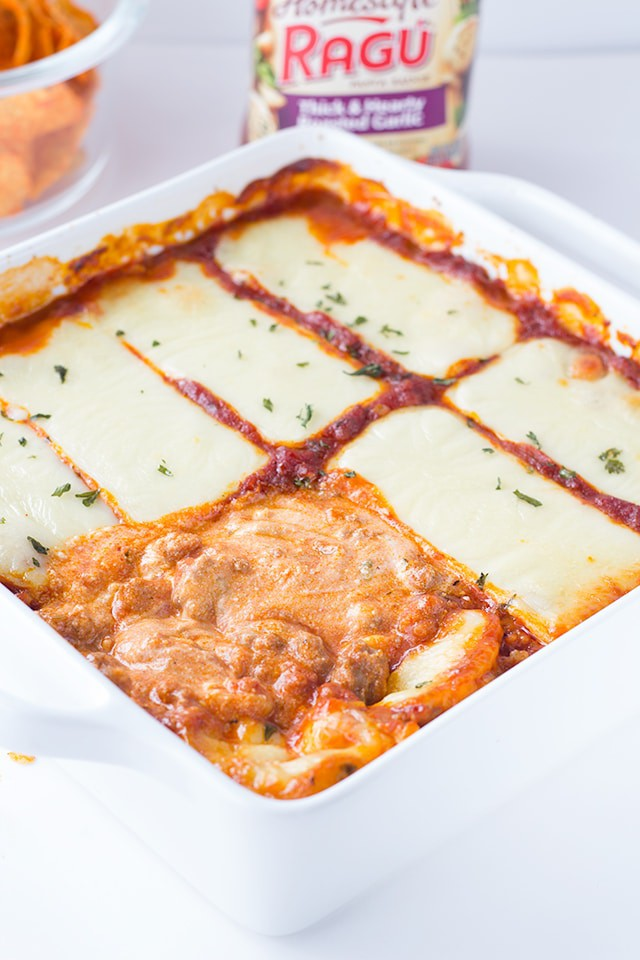 warm lasagna dip covered in slices of mozzarella cheese