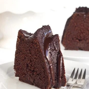 slice of homemade chocolate whiskey cake with whiskey-infused chocolate frosting