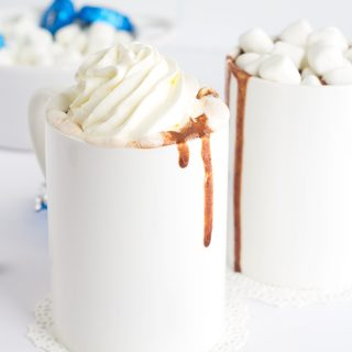 Thick and Creamy Slow Cooker Hot Chocolate. It's easy to throw together now and drink hot with marshmallows later! Easily customize it to be milk chocolate or semi-sweet chocolate!