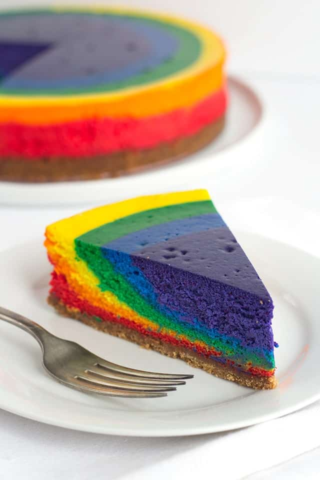vibrant colored slice of Rainbow Cheesecake