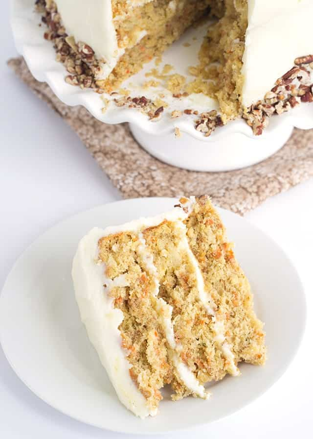 overhead image of a slice of Carrot Cake with Pineapple topped with Pineapple Juice infused Cream Cheese Frosting