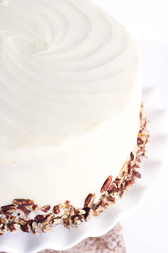Pineapple Carrot Cake with Cream Cheese Frosting, garnished with toasted pecans.
