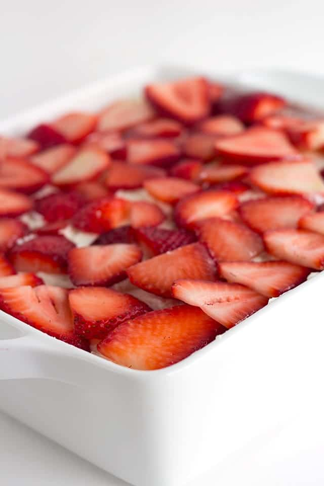 Strawberry Tiramisu - the perfect summer dessert. It's layered with strawberries, soaked in orange juice and limoncello for some bright, fun flavors.
