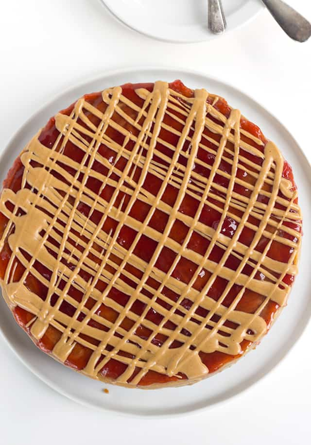 overhead of peanut butter and jelly cheesecake showing the topping