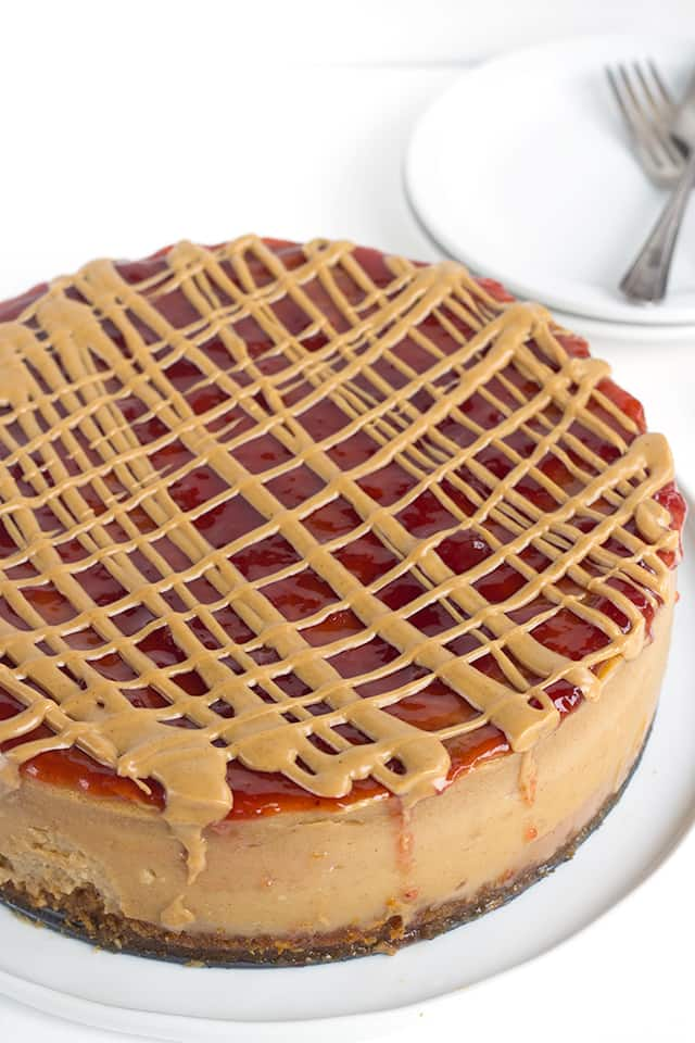 peanut butter and jelly cheesecake on a white plate