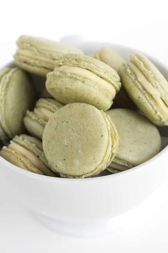 bowl of french macarons in a white bowl