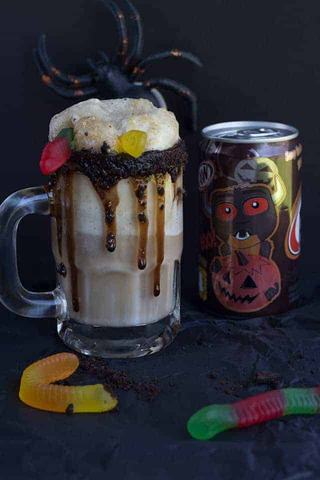 Dirt Cake Root Beer Float - The perfect spooky float for the kids! It has all the great flavors of the original float with a twist of chocolate cookie, chocolate syrup, and gummi worms!
