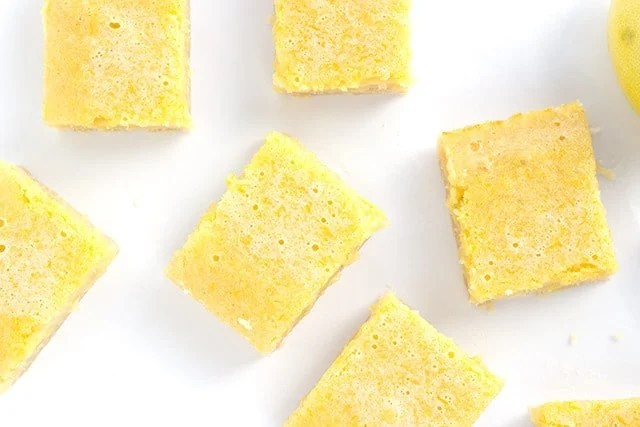 Lemony Lemon Bars - these easy lemon bars are a hit every time I make them! They're sweet with loads of tangy lemon flavor to them.