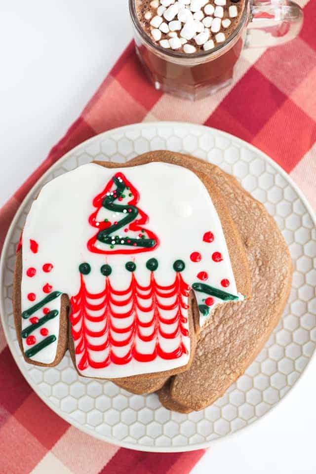 Hot Cocoa Cutout Cookies - Scrumptious cutout cookies full of hot cocoa mix and tiny marshmallows. Add some frosting and extra mallow bits to the cookies and enjoy!
