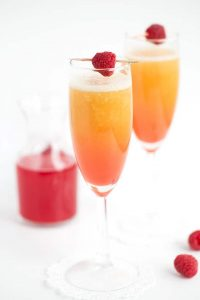 peach raspberry bellini with a raspberry syrup