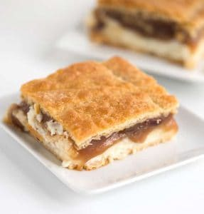one slice of pecan pie cheesecake bars