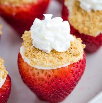 cheesecake stuffed strawberry on a white plate