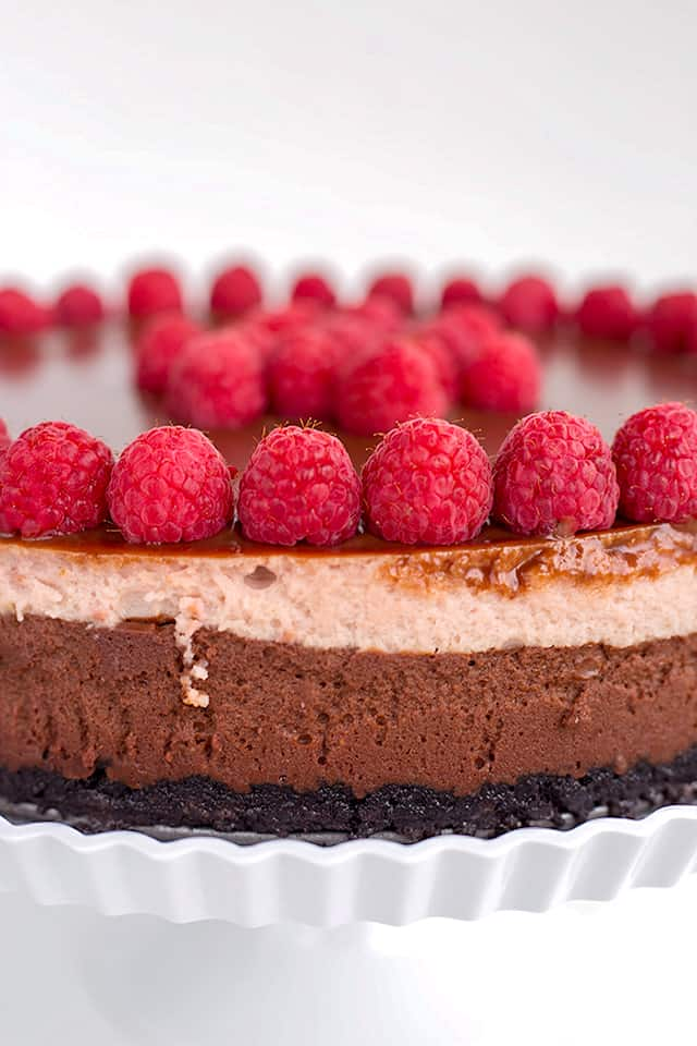 Close up of side of the chocolate raspberry cheesecake showing the chocolate and raspberry layers