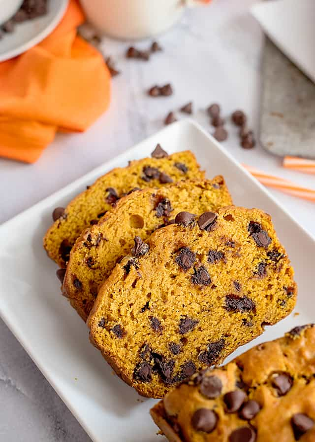 3 slices of pumpkin chocolate chip bread on serving plate