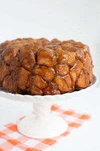 close up of monkey bread on a white cake plate