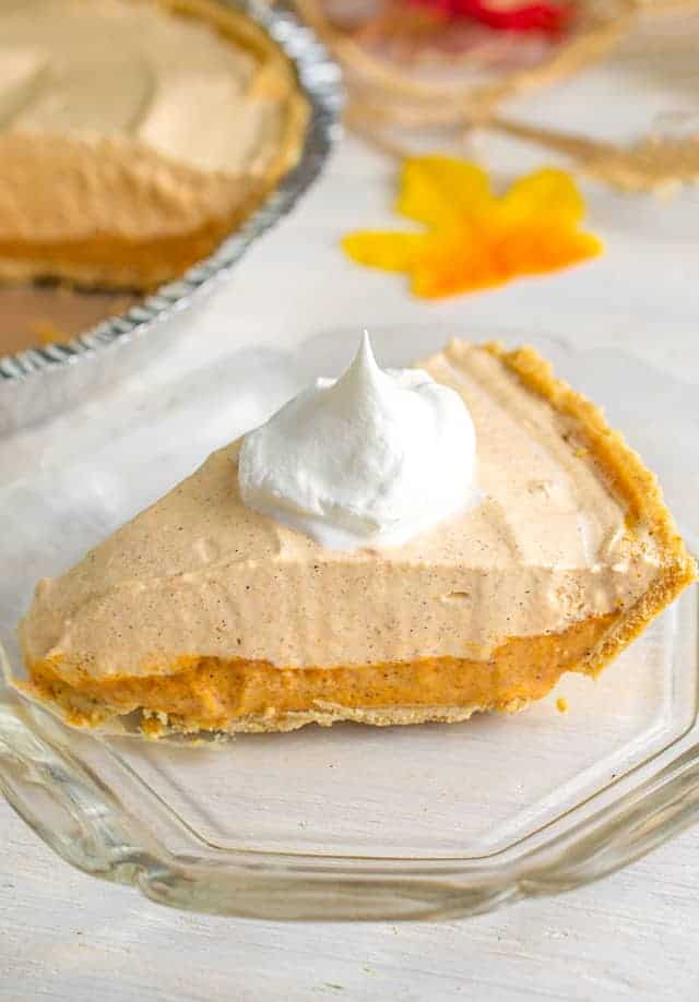 slice of pumpkin ice cream pie on a glass plate