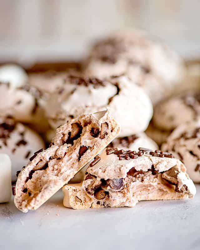 hot chocolate meringue cookie broke in half to see the inside