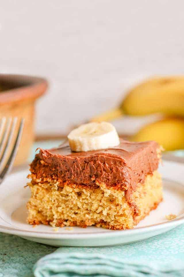 slice of banana cake with chocolate frosting