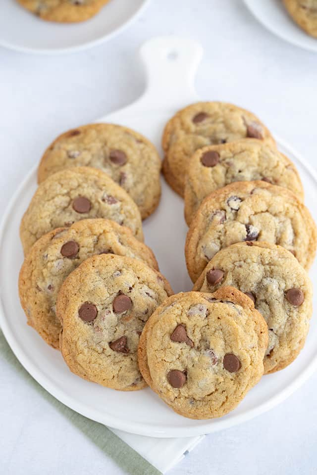 chocolate chip cookies lined up on a white platter