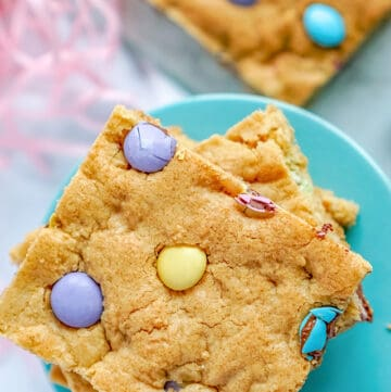 Easter Cookie Bars sitting on a blue cake plate