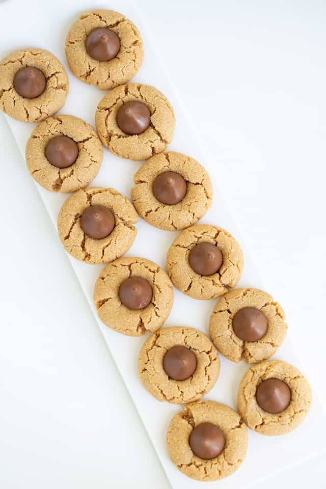 Two rows of Hershey Kiss Cookies on a white platter