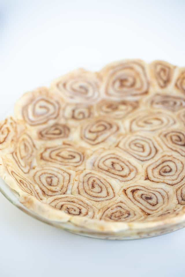 pie crust in a pie plate with a white background