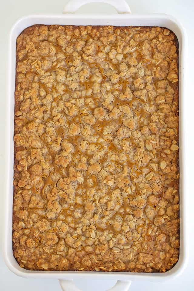 overhead photo of a white pan full of pumpkin crisp