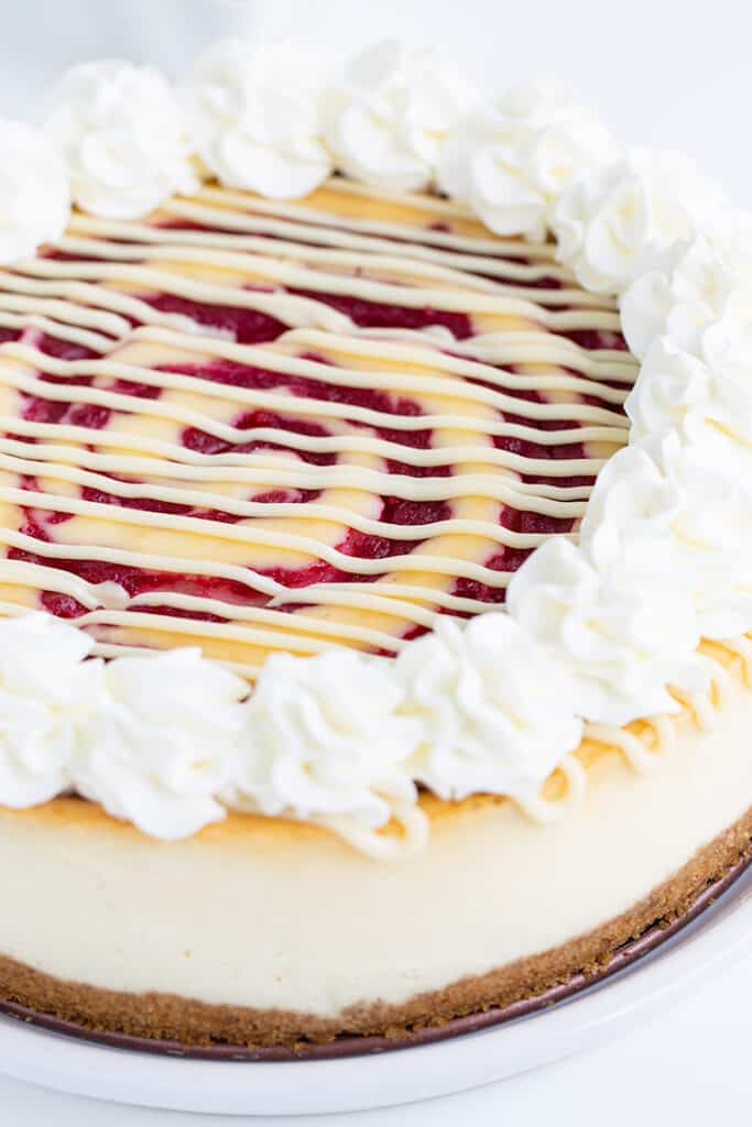 whole cheesecake on a white plate