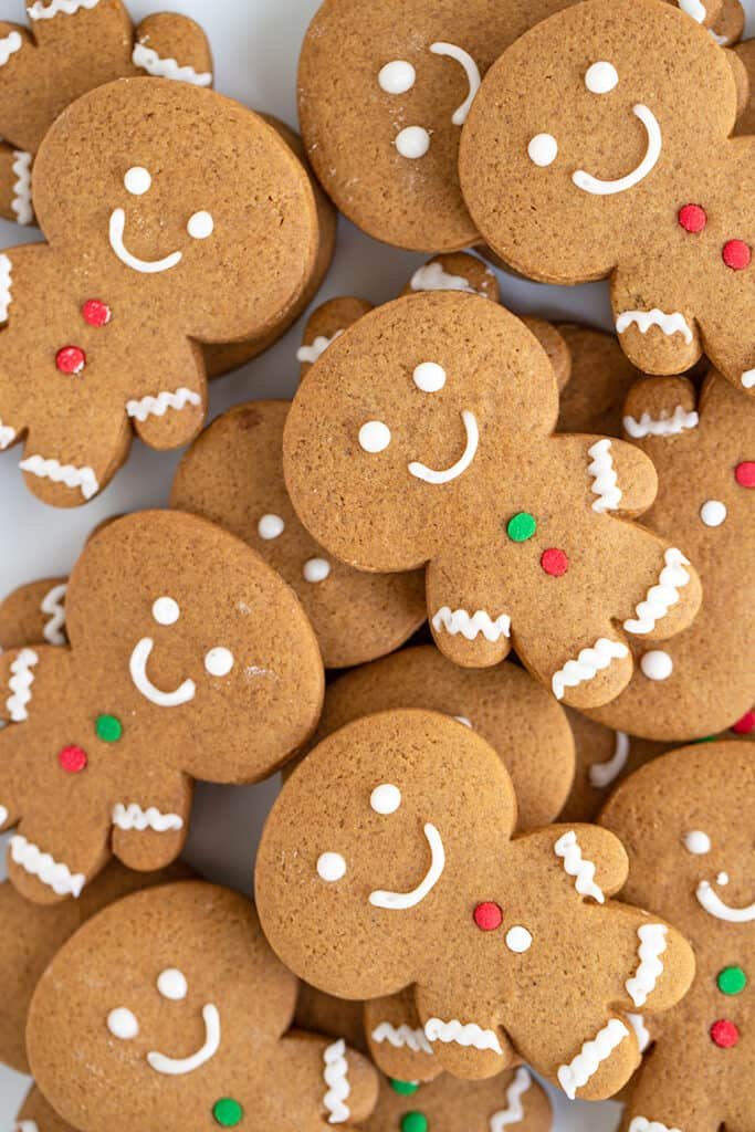 overhead photo of stacked decorated gingerbread cookies