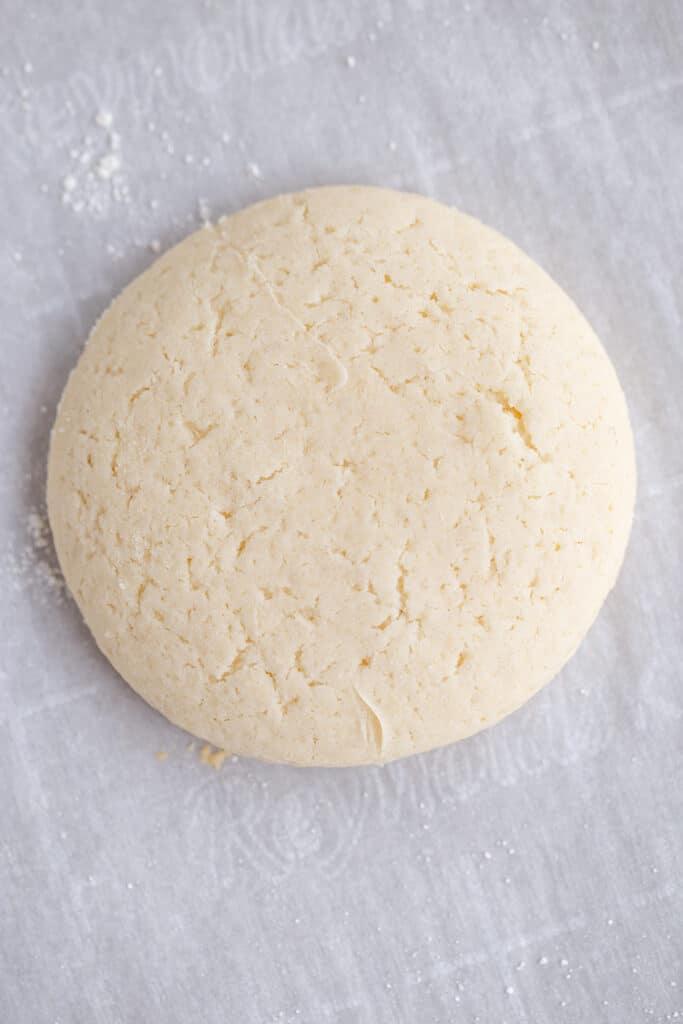 plain sugar cookies on a piece of parchment paper