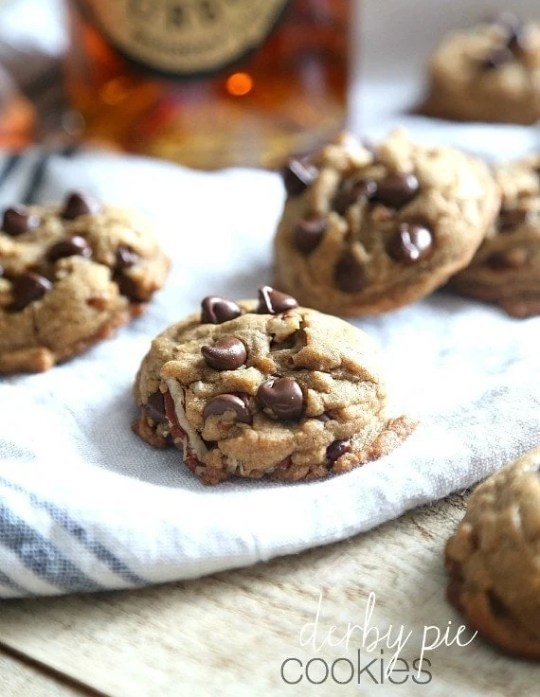 Derby Pie Cookies! These cookies are browned butter, bourbon, pecan chocolate chip cookies loaded with rich brown sugar! They're soft on the inside and crispy on the outside!