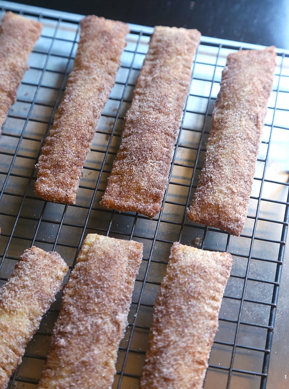 Dulce de Leche filled Churro sticks...so easy if you start with a premade pie crust!