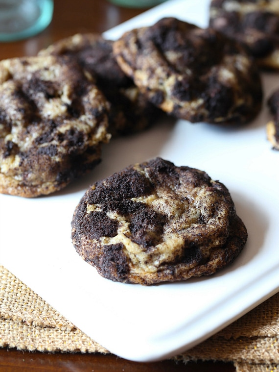 Dirty Chocolate Chip Cookies...these are super soft chocolate chip cookies loaded with Oreo bits ROLLED in Oreo dust! LOVE these!