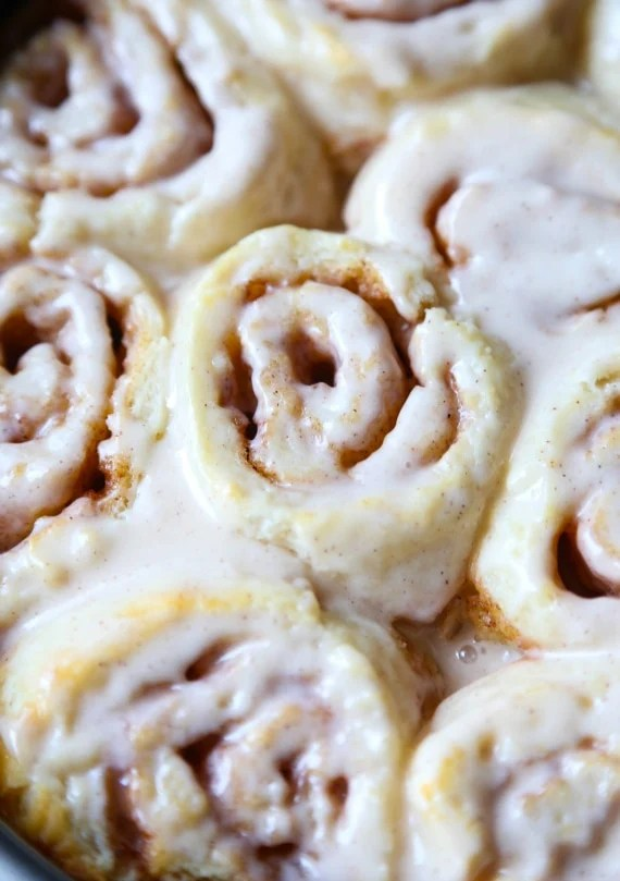 Super easy Warm and glazed Biscuit Cinnamon Rolls...so easy and ready in under 30 minutes!