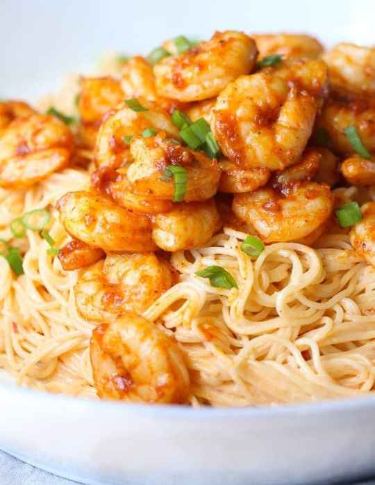 Skinny Bang Bang Shrimp Pasta is loaded with flavor and lighter on calories! Made in 30 minutes!!