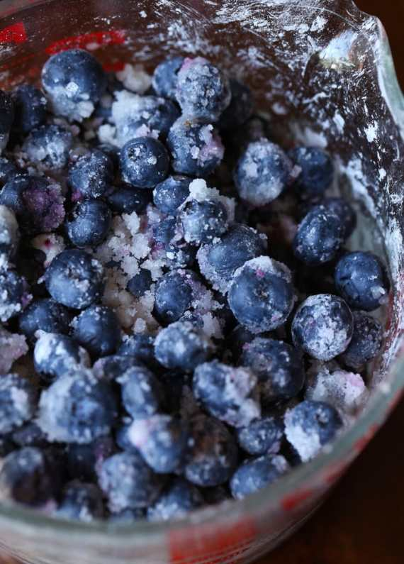 Fresh blueberries coated in sugar for Blueberry Crumble Bars