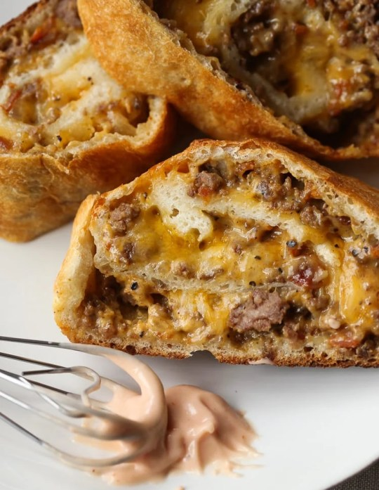 GARBAGE BREAD!! This is a simple recipe that can be adapted SO many ways! Bacon Cheeseburger Garbage Bread is our favorite, but throw your leftovers in a pizza crust and roll it up! The possibilities are endless.